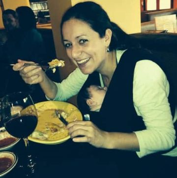 Mom with baby in wrap at a restaurant