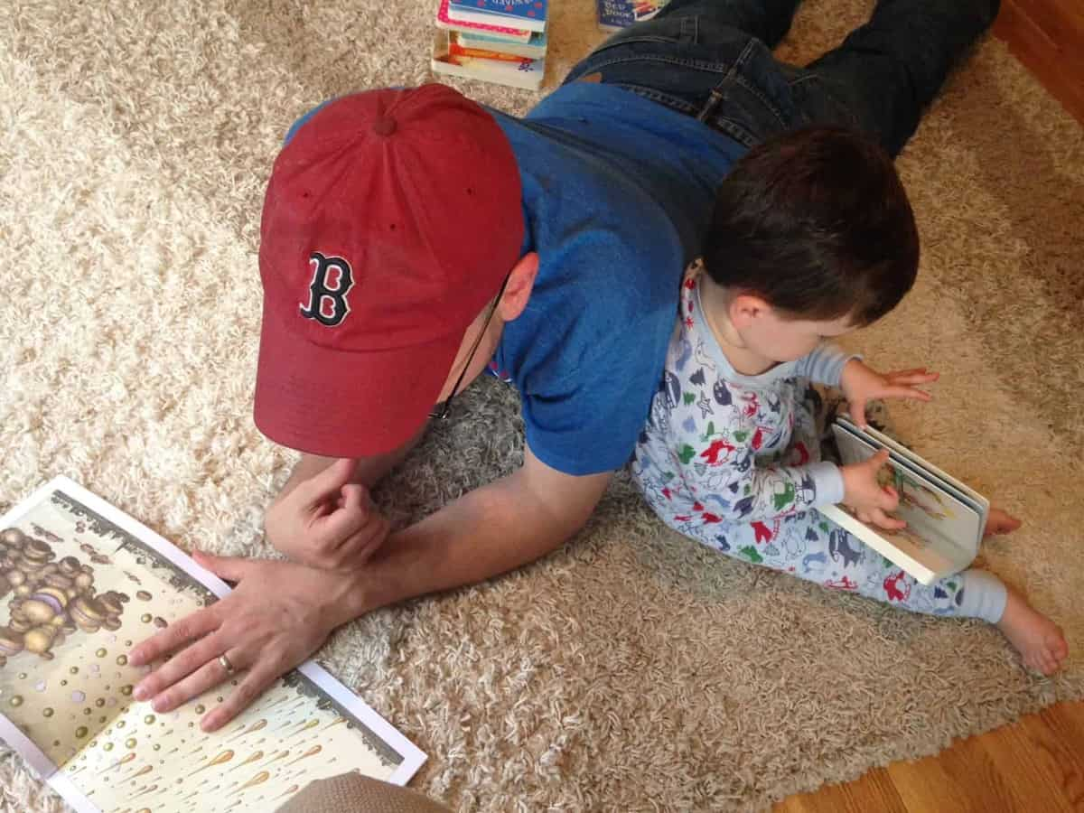 Father and son reading one of the best books for toddlers