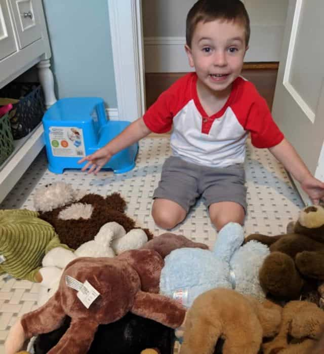 boy with stuffed animals