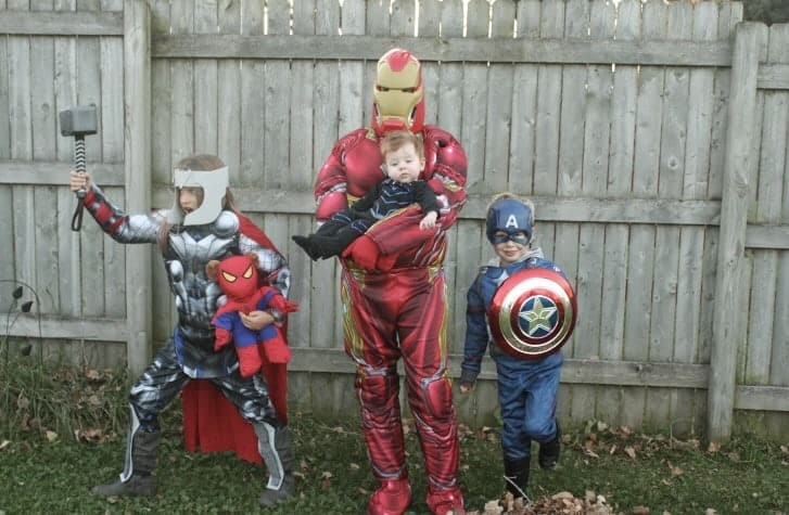 Family dressed up in The Avengers costumes