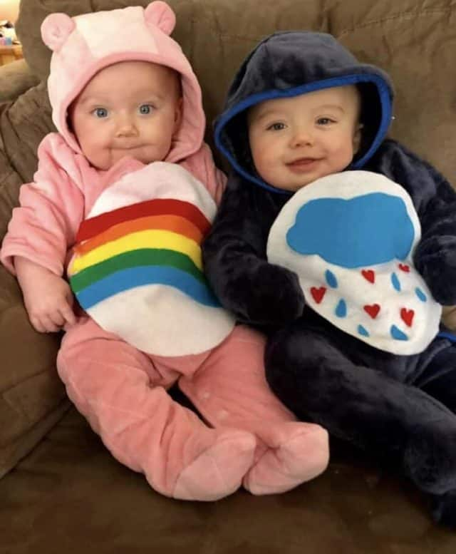 Babies dressed in Care Bears costumes