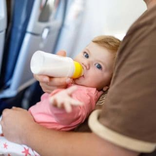 baby with bottle on plane