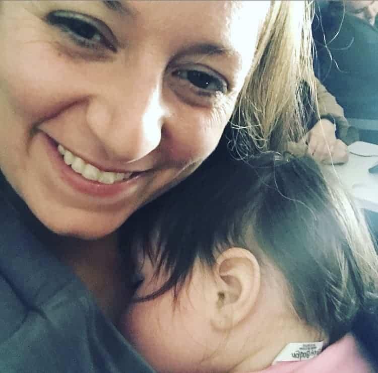mom cuddling a baby