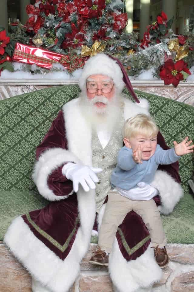 blond boy crying on Santa's lap