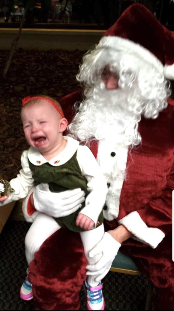 girl crying on Santas lap
