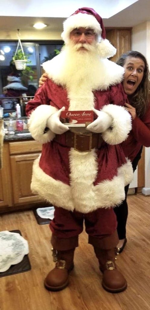 woman hiding behind Santa