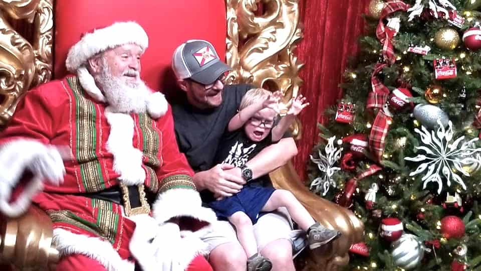 father and son with Santa