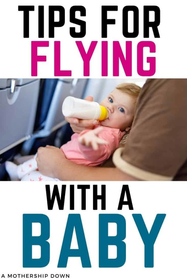 baby taking a bottle on a plane