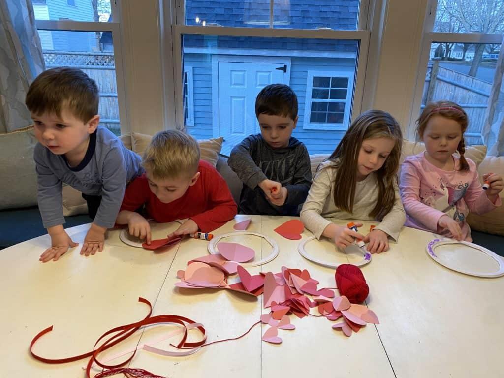 kids working on valentine's day craft