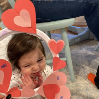 baby and a valentine's day craft