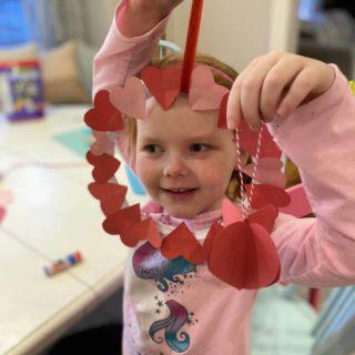 little girl with heart wreath