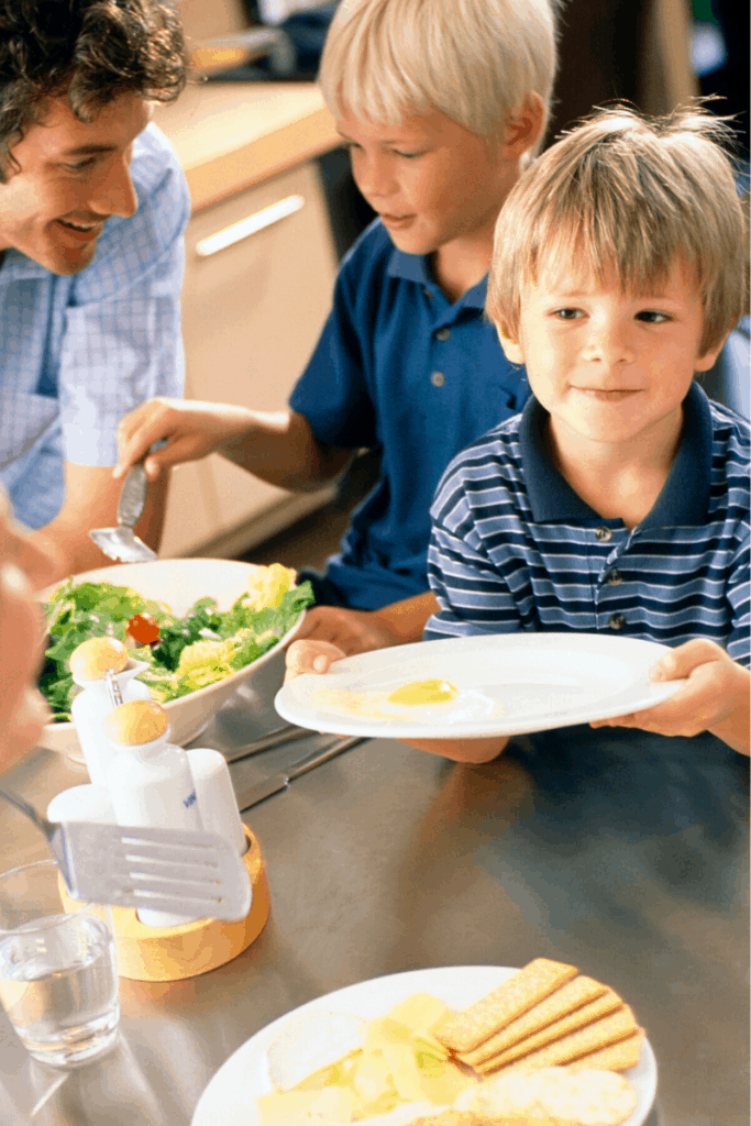 boy filling up his plate at a family meal
