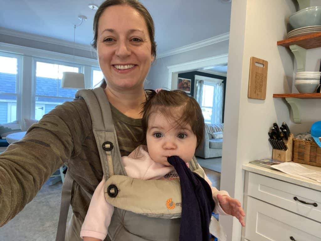 Mom with forward facing baby in ERGO360 carrier