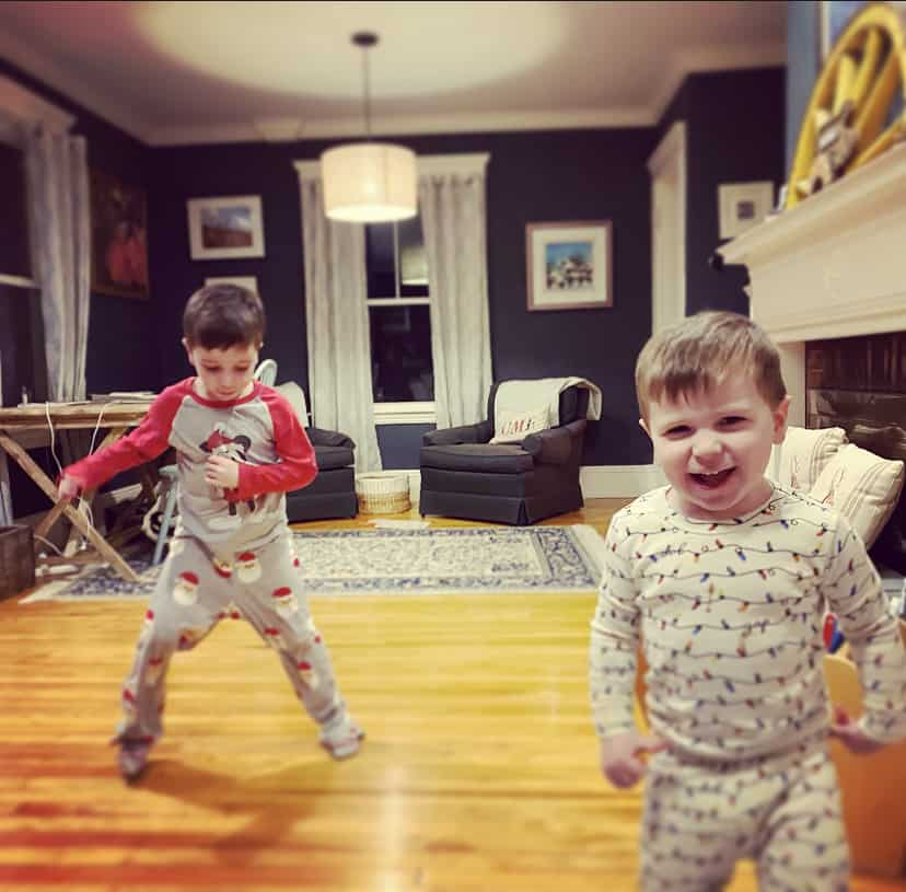 two little boys dancing in pajamas