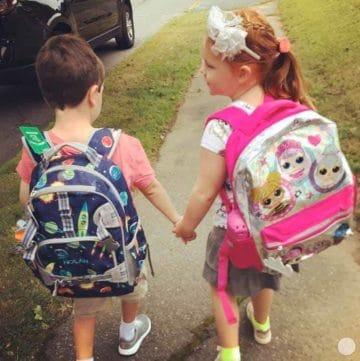 kids walking to school, holding hands