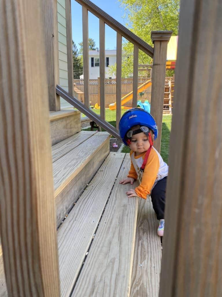 baby wearing a bike helmet