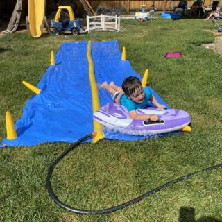 boy on slip and slide