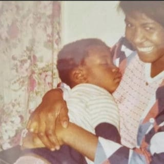 George Floyd as a baby with his mother