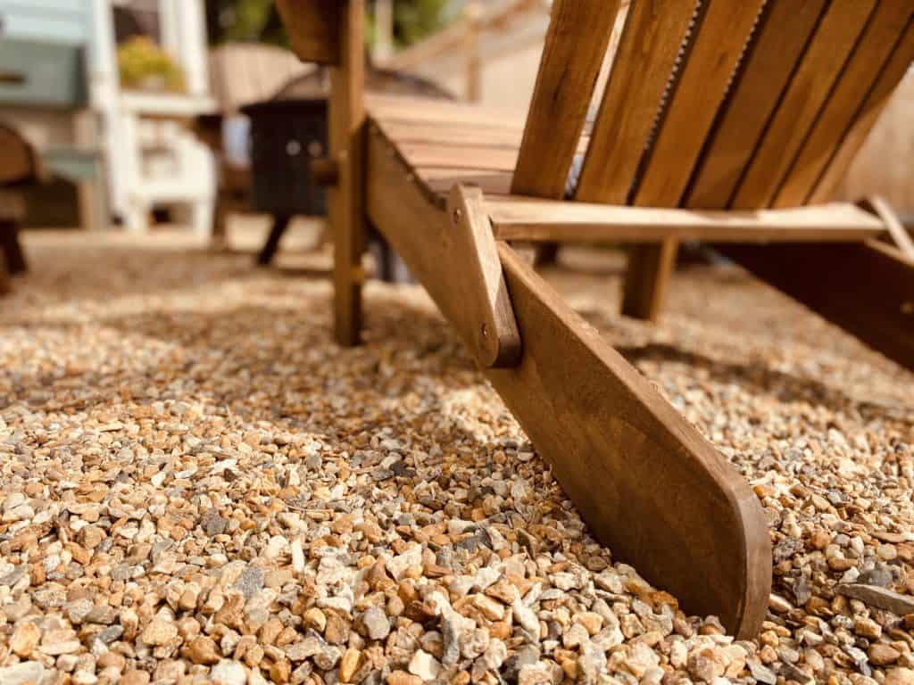 adirondack chair on pea gravel patio