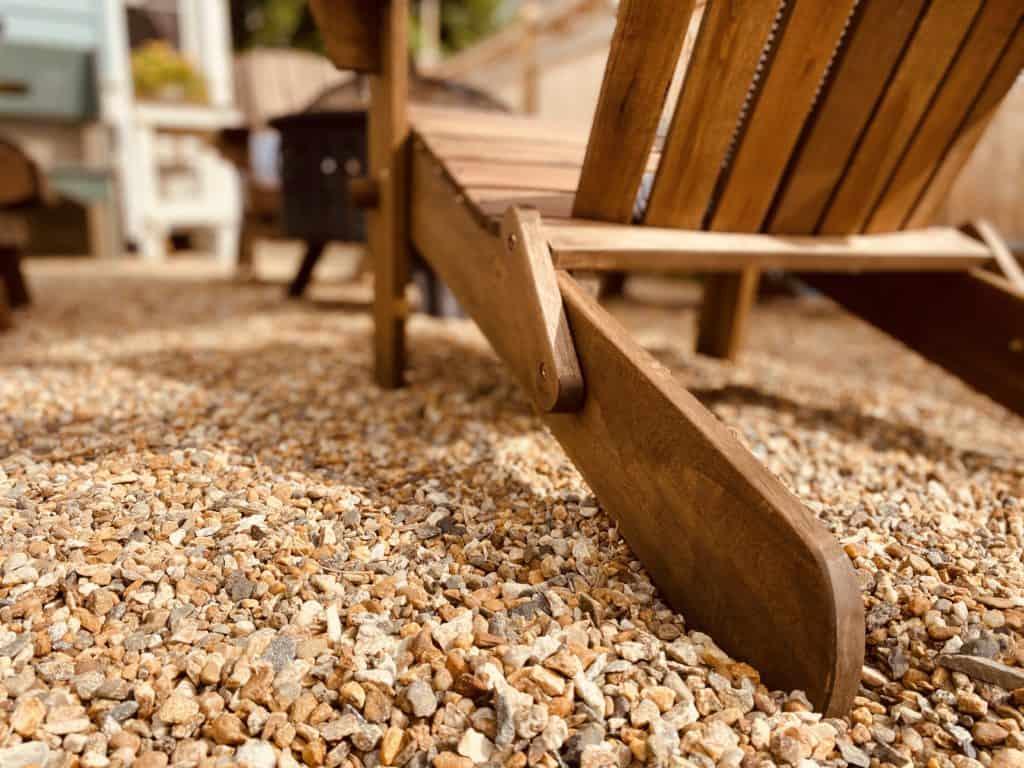adirondack chair on pea gravel patio