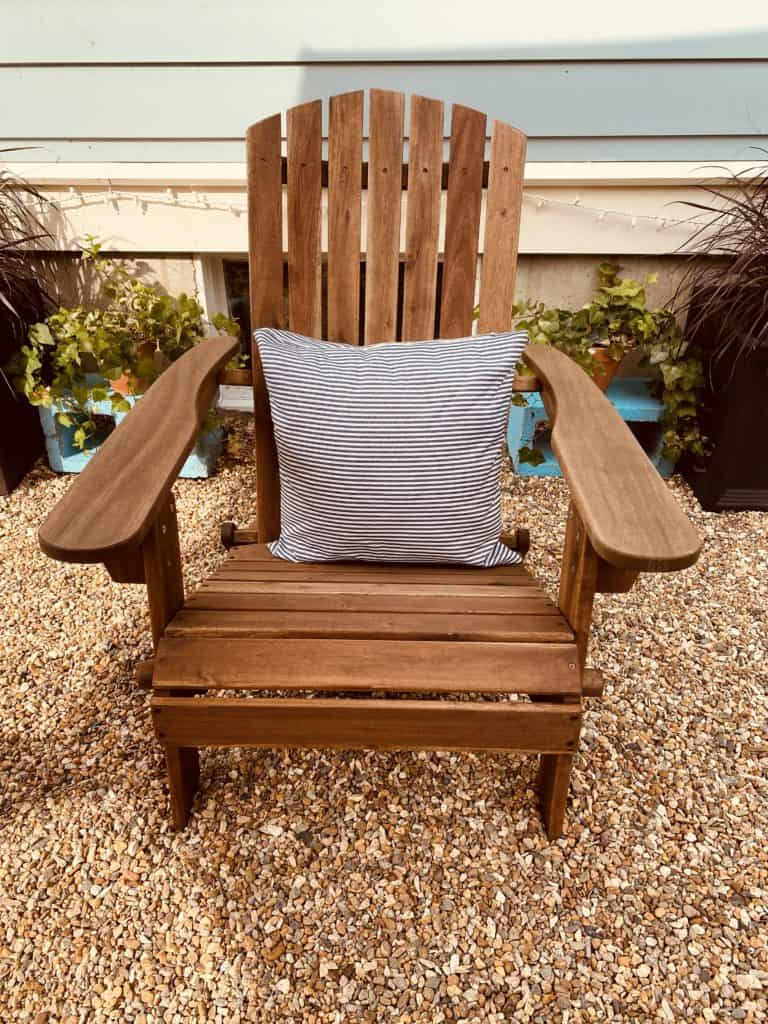 Adirondack chair with stripped pillow