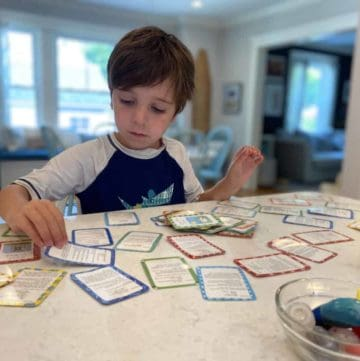 boy doing flashcards at the kitchen counter