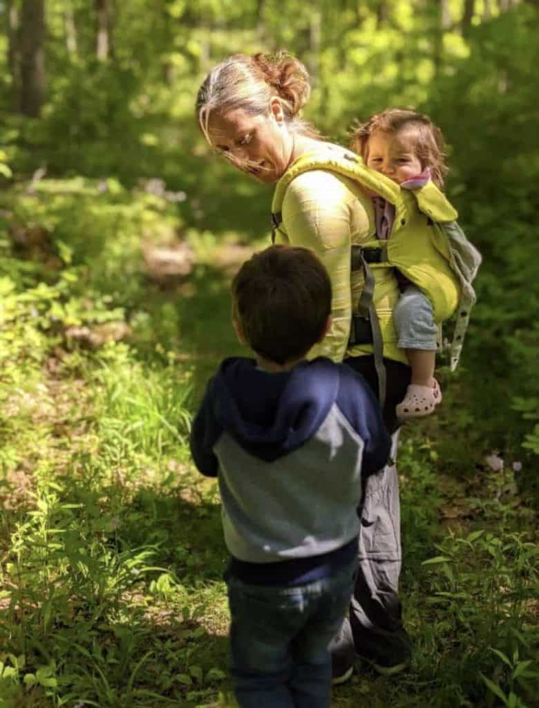Mom hiking with two kids