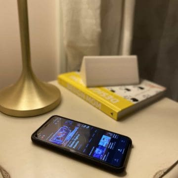 cell phone on a nightstand