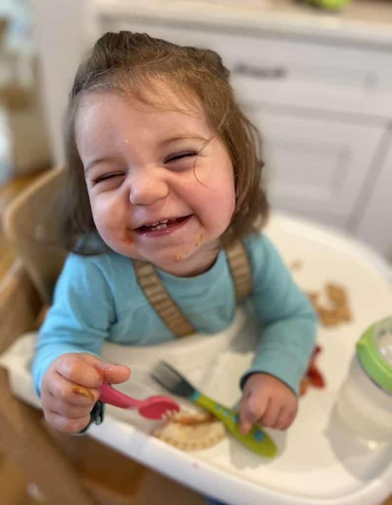Toddler girl in Tripp Trapp baby set