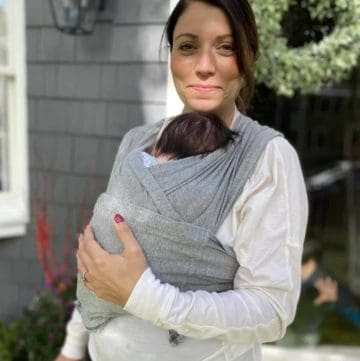 mother using Baby K'tan wrap