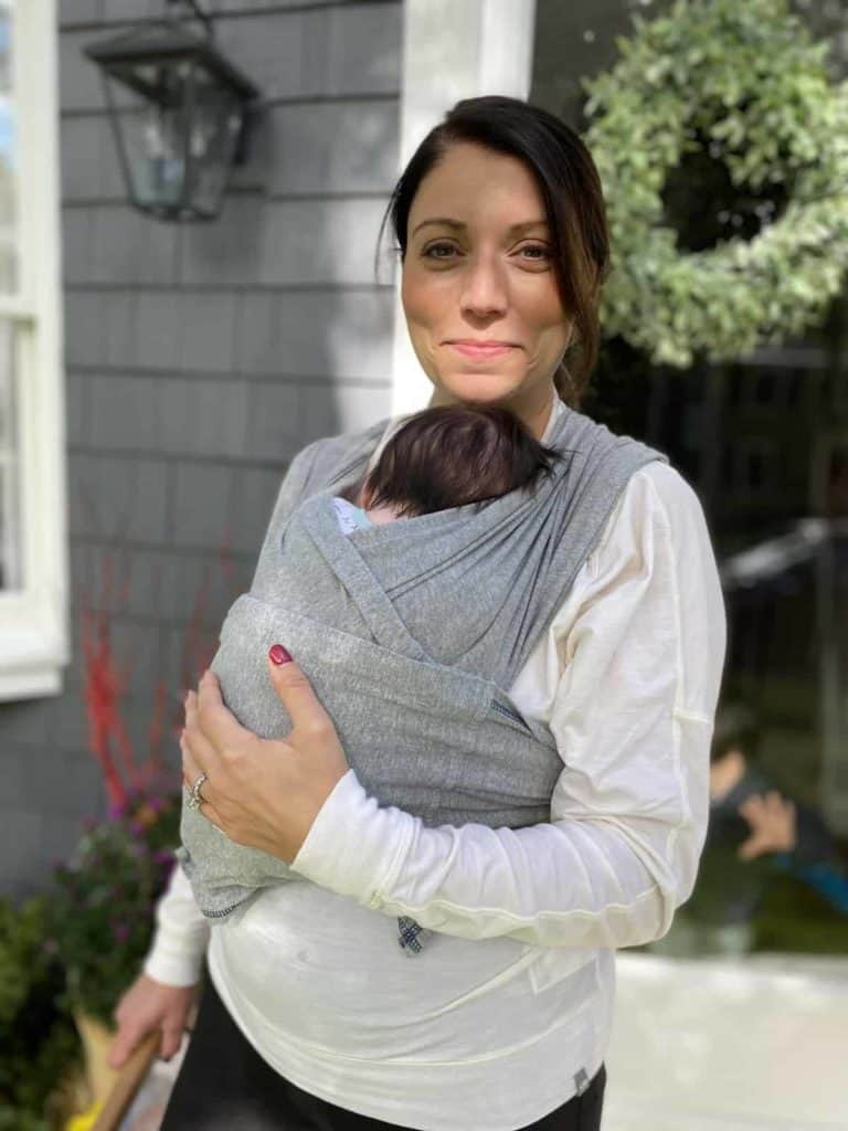 mother using Baby K'tan wrap