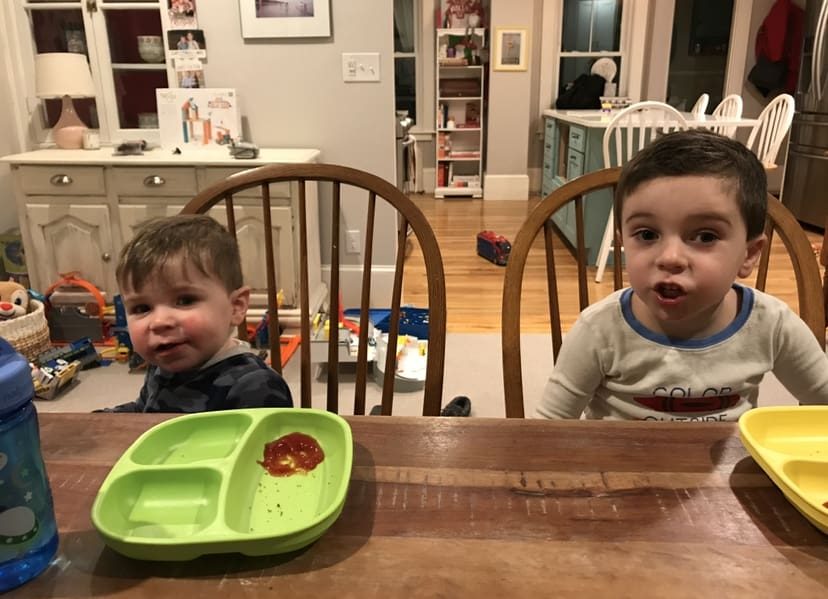 Toddler at the dinner table using a standard size chair