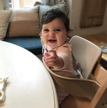 baby pulled up to table in Tripp Trapp chair
